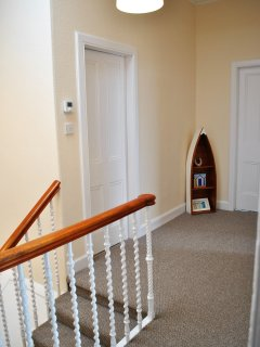The hall has a large walk in storage area- perfect for suitcases and golf clubs!