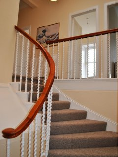 The sweeping staircase that leads to the accommodation