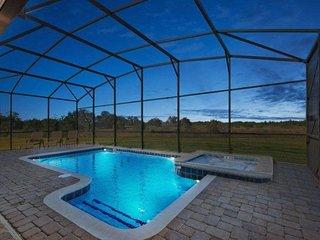 5 Bedroom 4.5 Bath Pool Home in Gated Golf Resort. 2393VD