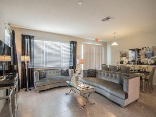 5137CHD. Glamorous 4 Bedroom 3.5 Bath End Unit Town Home Located in Compass Bay
