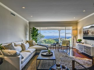 Beautiful home with bright decor, floor to ceiling windows, ocean and city views - Riviera Sightlines