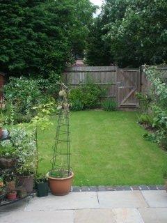 The rear garden has a patio and cottage garden