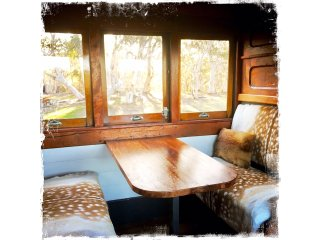 Carriage 343 dining table booth has original railway seats upholstered in fallow deer
