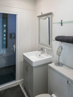 Bathroom with Double Shower and Steam Room.