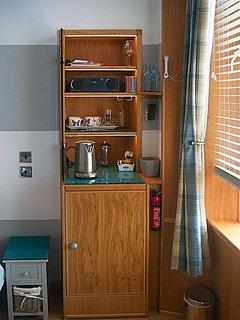 tea, coffee, glass area with kettle and fridge