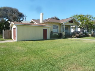 House is centrally located in Galveston with large front yard