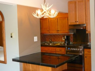 antler chandelier and granite dining counter