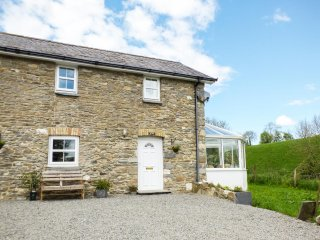 TY NANT, semi-detached, WiFi, private enclosed courtyard, near Llanllwni Mountai