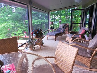 Beautiful screened-in porch overlooking the spectacular views.