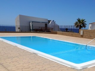 Apartment Poris with pool and sea view