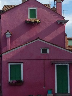 Traditional, art-filled, pink waterfront house,  great views, close to Venice.
