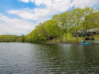 Lakefront home w/ incredible views, a private dock, deck & water slide!