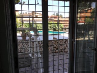 Apartment 90 mt 2 with garden and private swimming pool and fitness room