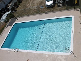 NEWLY RENOVATED KITCHEN!  Family friendly mid-town location with pool!