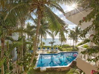 Kid- friendly Beachfont condo with a pool - Quiet community, Wifi, AC