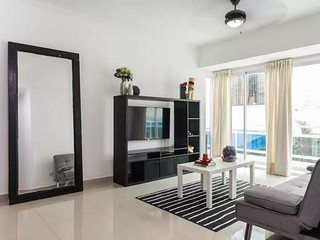 The livingroom comes with an open fully equipped kitchen, balcony, seating area, Smart tv with cable