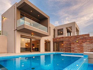 Spectacular cliff edge villa with sea & sunset views & heated pool and hot tub