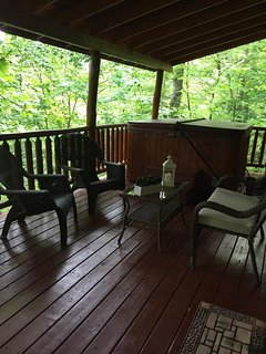 New patio furniture on back deck for rest and relaxation.  Feels like you are in a giant treehouse!