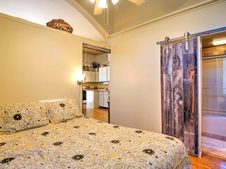 This condo features a private bedroom with homey decor and bathroom access.