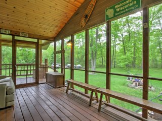 Enjoy your morning coffee on the screened-in porch, which overlooks the lush backyard.