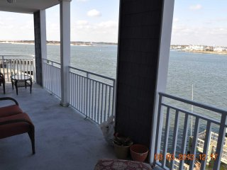 Large Bayfront Condo Downtown close to Boardwalk, Beach, Private Pier to Fish Gr