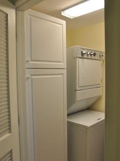 Utility Closet with full-sized Washer/Dryer