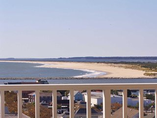 Large Penthouse Level Condo on Boardwalk with 60' Balcony facing Assateague Isla