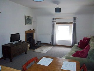 Spacious Airy Living Room with central heating, working fireplace, comfy large sofa.