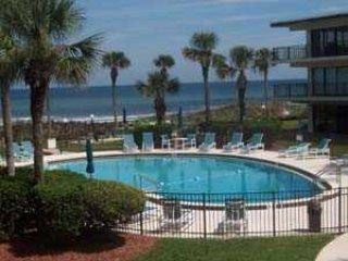 Ground floor - pool front - ocean views - Ocean House Condo # 104