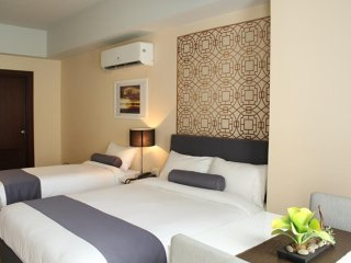 CSuites at Two Central Residences: Twin Suite