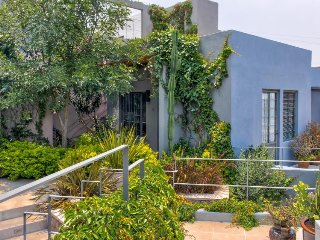 Colorful casita w/ furnished patio and terrific city views - short walk to town