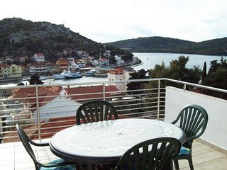 AM 1064 Lucy Two-Bedroom Apartment with seaview near the bridge in Tisno(5+0)