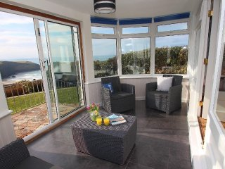 GWILLEN welcoming family home, tiered garden, overlooking the beach at Mawgan