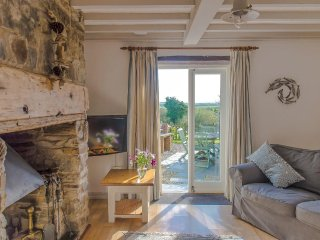 GRANARY COTTAGE, family coastal cottage, part of group of five, dog friendly