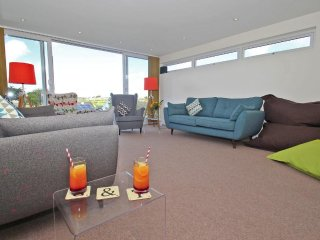 SEAGRASS modern family home, large garden, games room, just beyond the beach at