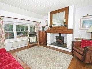 TREHAN terraced stone built cottage, wood burning stove, enclosed garden