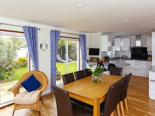 GLEBE HOUSE, large modern family residence, enclosed garden, in the village of