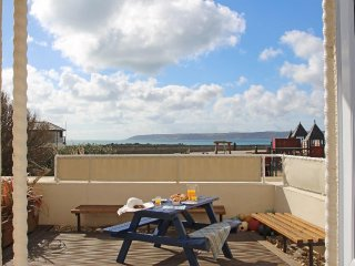 CASTAWAYS modern ground floor seafront apartment, private decked terrace, in
