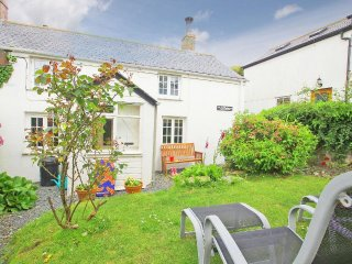 ELFIN COTTAGE, enclosed garden, central location in small harbour town, Ref