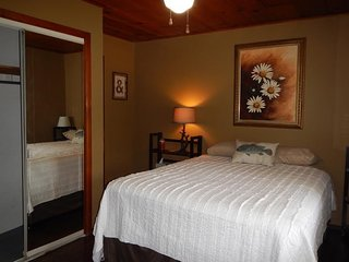 Master bedroom with full bath in Cabin 8