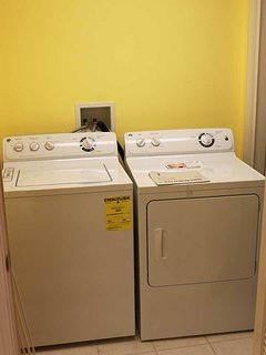 Utility Room with Full Sized Washer and Dryer