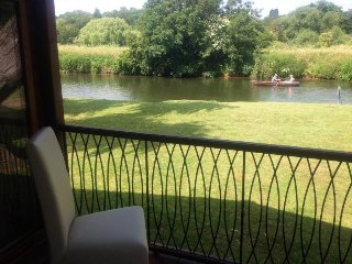A Midsummer Nights Dream Lodge on the River Avon on the waterfront.