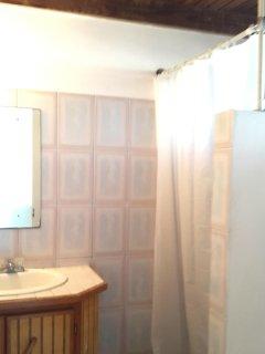 En suite bathroom with walk in shower, hot/cold water