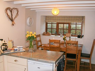 HOLLY COTTAGE, detached stone cottage, open fire, decking area, garden, near