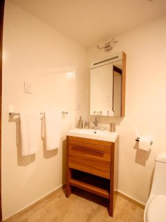 Master Bathroom with white linens provided