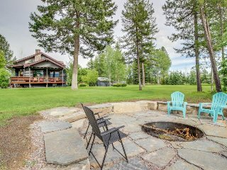 Riverfront getaway w/ spacious deck, dock, and firepit! On 16 acres!