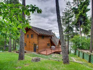 Three-level lakefront cabin in the woods w/ large docks, two decks, & media room