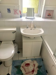 Bathroom with electric shower over the bath. Toiletries and towels supplied