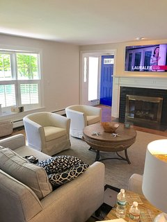 Living room with 55' flat screen TV and view of front door