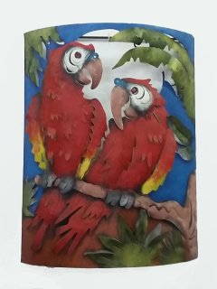 A local metal scuplture of 2 scarlet macaws in the living area.